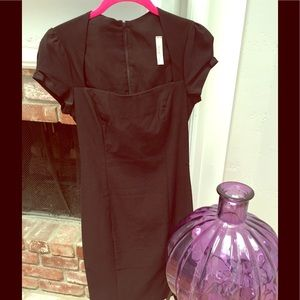 Black form fitting midi length pencil dress